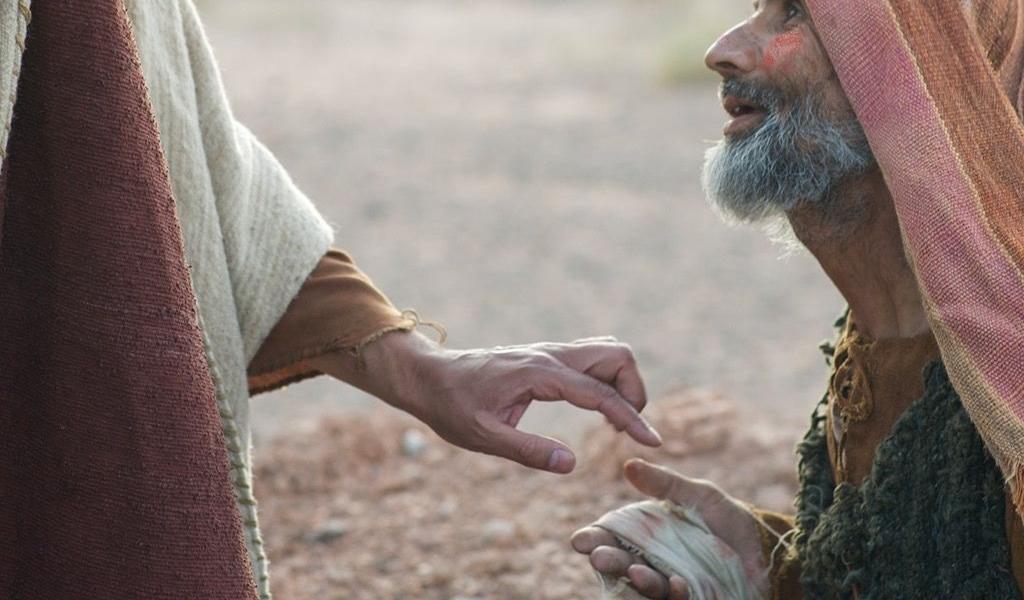 Jezus, zdjęty litością, wyciągnął rękę